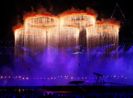 The Olympic rings are illuminated with pyrotechnics as they are raised above the stadium during the Opening Ceremony at the 2012 Summer Olympics, Friday, July 27, 2012, in London. (AP Photo/Jae C. Hong)
